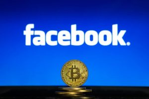 Bitcoin stack in front of Facebook Logo