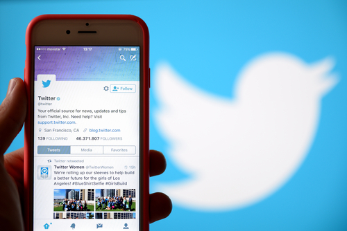 Twitter on mobile device in hand